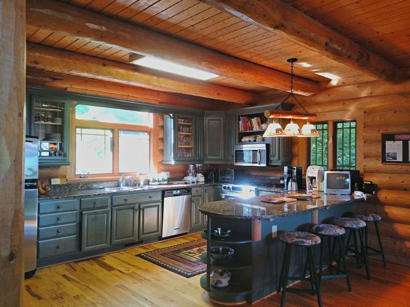 Very well appointed  kitchen with double ovens, granite, all pots/pans/dishes