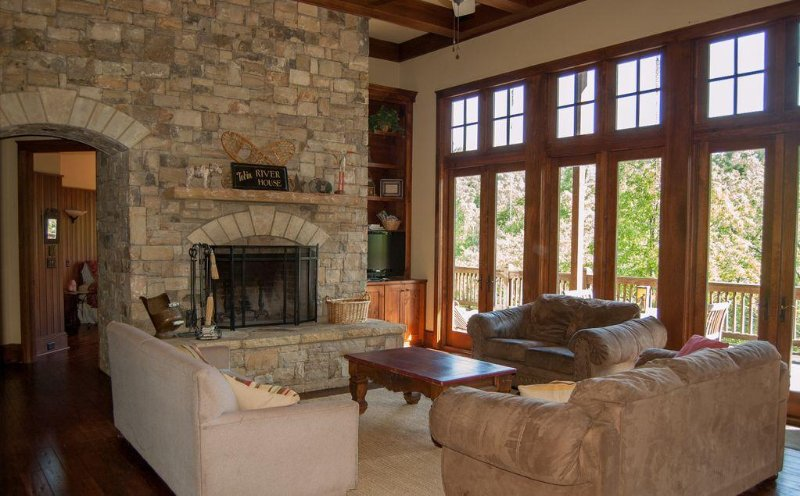 Great Room with Wood Burning Fireplace and Lots of Windows to Enjoy the Mountain Scenery,