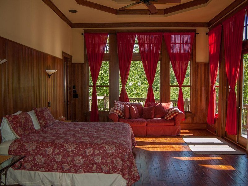Spacious Master Bedroom with King Size Bed and Sitting Area.