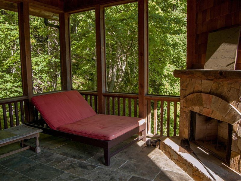 Private Porch Off Master Bedroom with Wood Burning Fireplace.