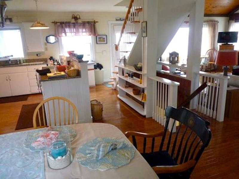 Kitchen area from dining (rear) area.  Open living throughout. Ocean views front