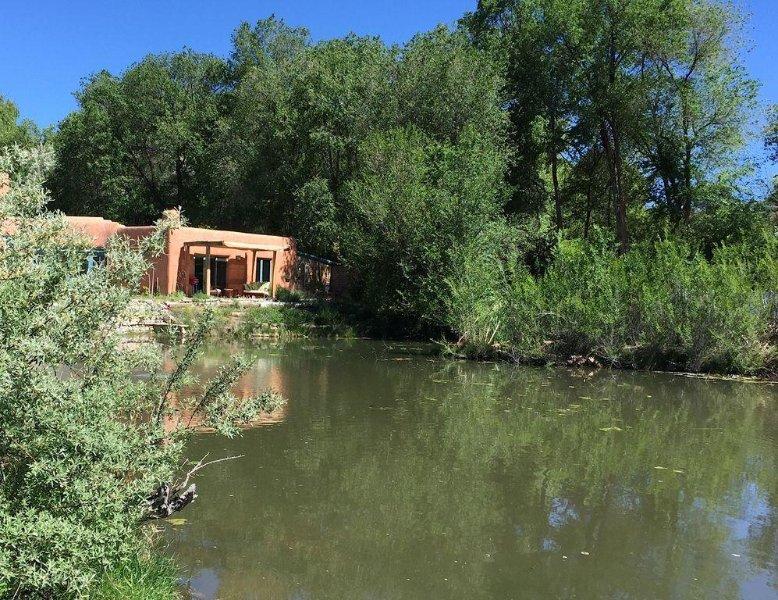 Unique Chimayo Village Adobe Casita on a wildlife pond between Santa Fe and Taos, holiday rental in Espanola