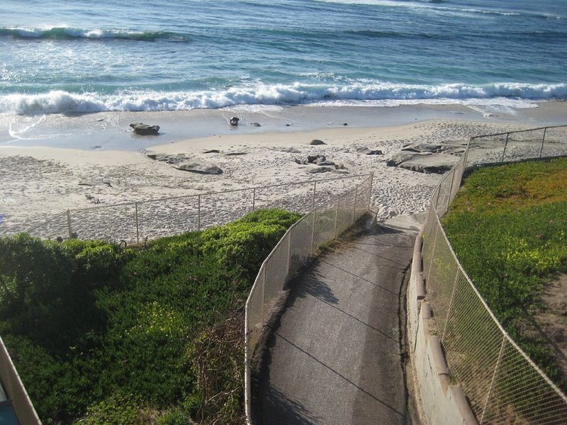 View of beach access ramp adjacent to home.