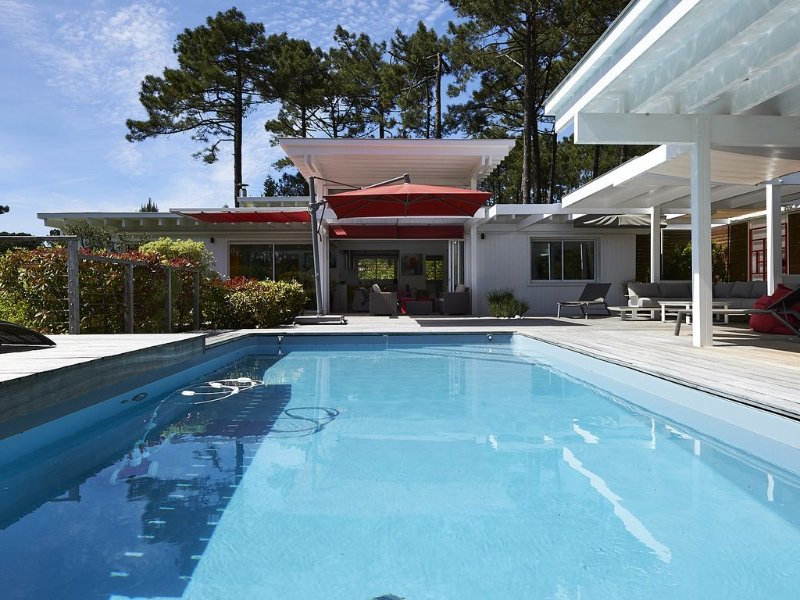 Villa wood architect. conditioned. heated pool. WIFI, vacation rental in Cap-Ferret