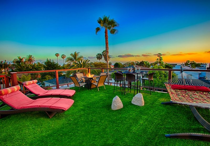 Guests have exclusive access to the private large ocean view roof deck with lounge chairs, fire pit, hammock, and seating for four people.