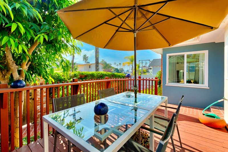 Backyard deck offers the opportunity to dine outside and enjoy the beautiful La Jolla weather.
