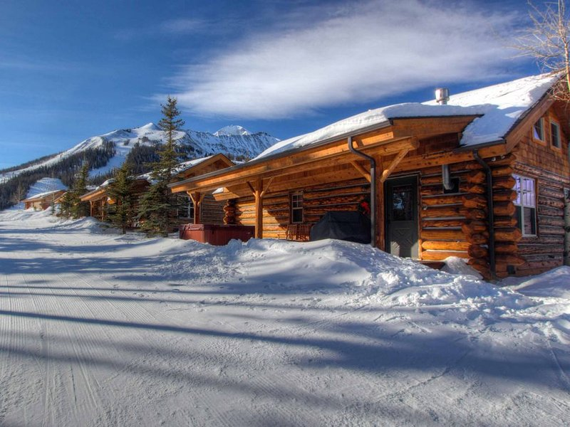 Step off porch onto slope - Ski-in/out Cowboy Heaven Cabin/Private Hot Tub/Views, holiday rental in Big Sky