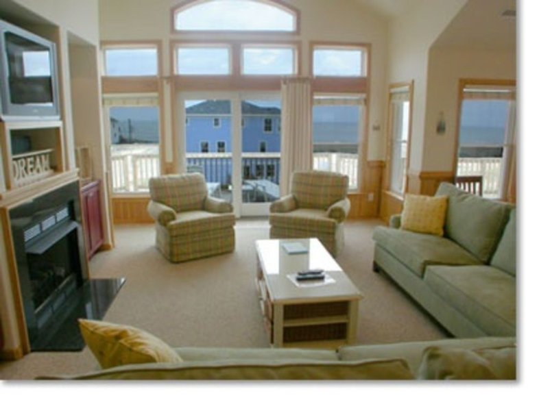 Living room - Beautiful views of the ocean from all levels of this home.   (pictured fireplace for owner use only)