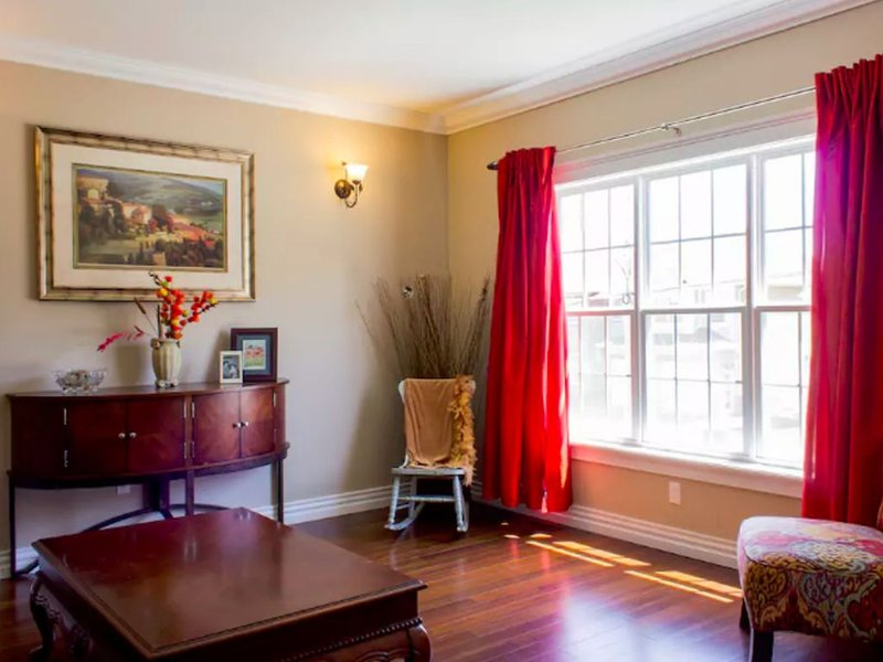 Mail Level Front Room with Cathedral Ceilings