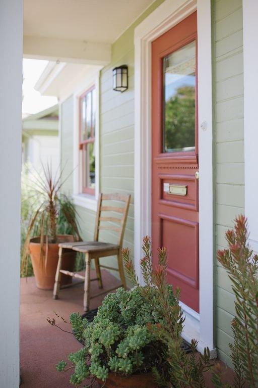 Front Porch.  Steps down to garden table,. Great for morning coffee.