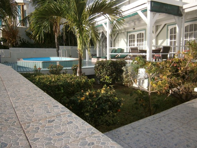 Seawall view to Garden, pool deck.  Your own Caribbean Oasis awaits.