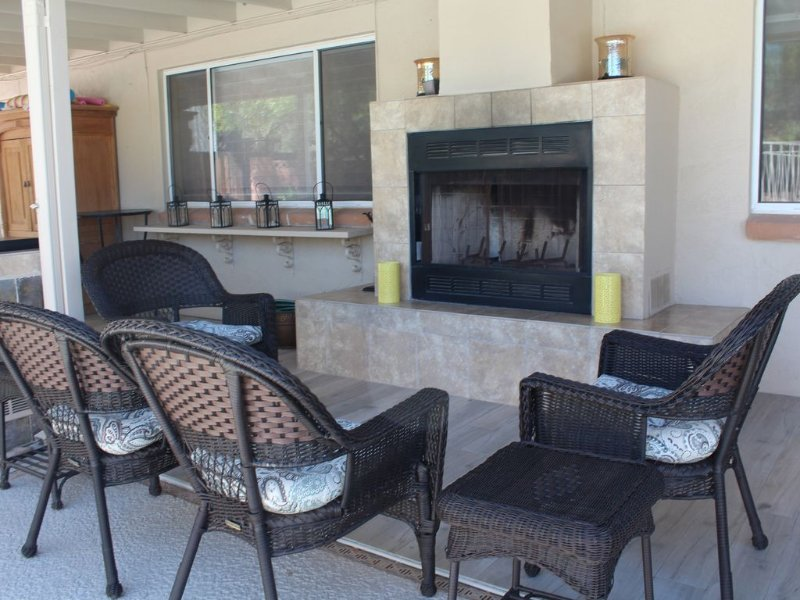 Outdoor seating by the fireplace.