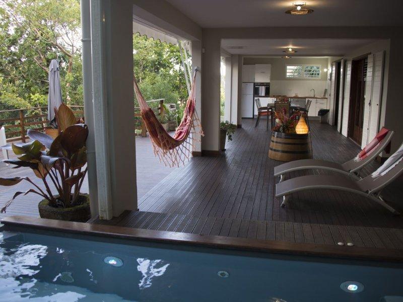 Suite de charme, spa privé, cadre verdoyant, pour 4 personnes, location de vacances à Le Moule