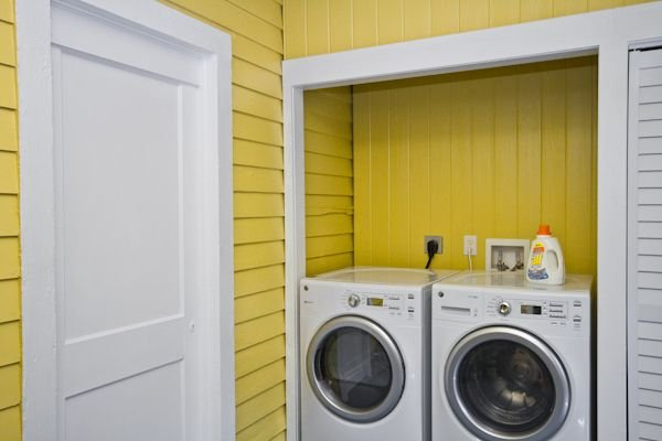 Spacious laundry room.  Brand new washer/dryer.  Door from laundry room leads out to side patio & yard.