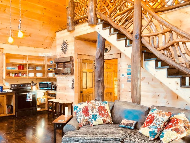 The custom built couch and 'TreeHouse Stairs' in the new cabin main living area