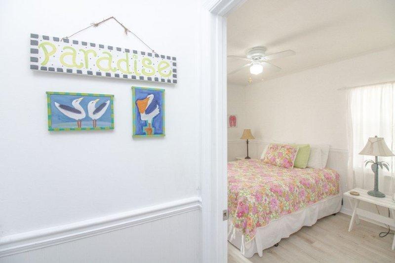 Queen bedroom with half bath.