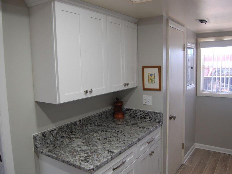 Shaker White cabinets with granite countertops