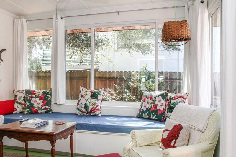 Florida room with tall windows make you want to curl up with a good book... or take a good nap!