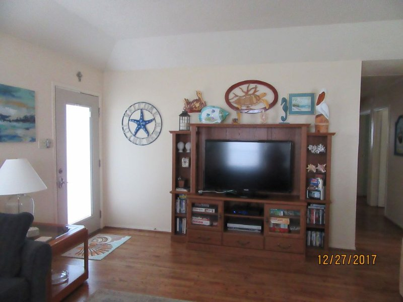 Walk in to the Living Room with Hardwood Floors and 46' TV with HD Cable