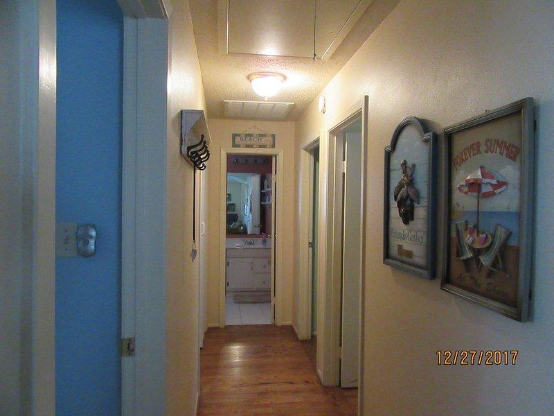 Hallway to Bedrooms and Second Bathroom