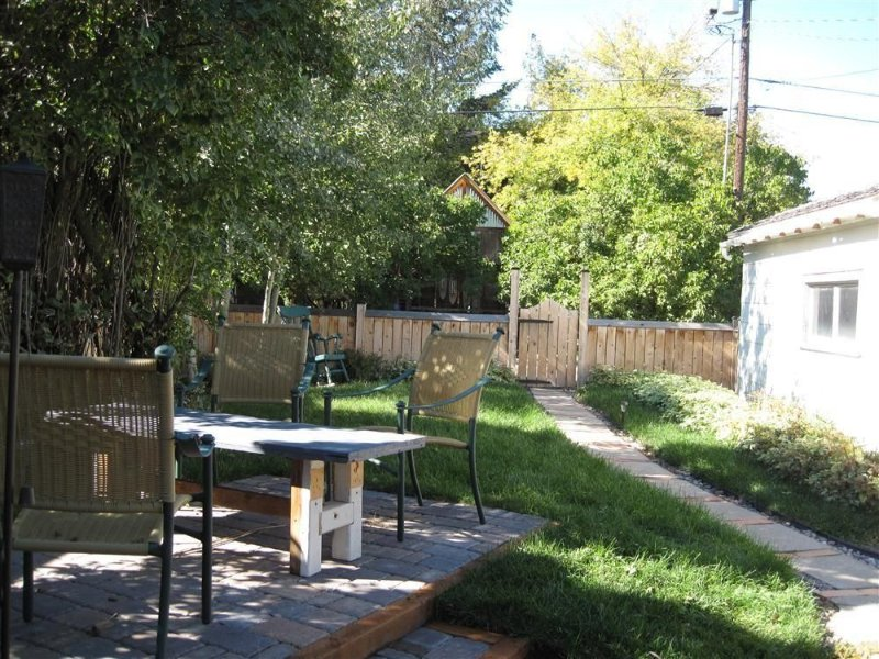 Private back yard with seating area and barbeque
