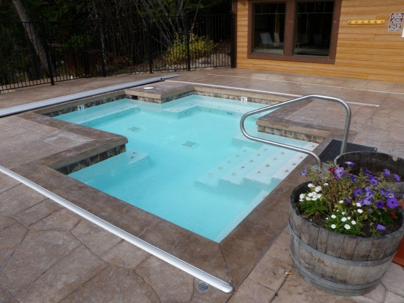 Shared outdoor hot tub with indoor pool
