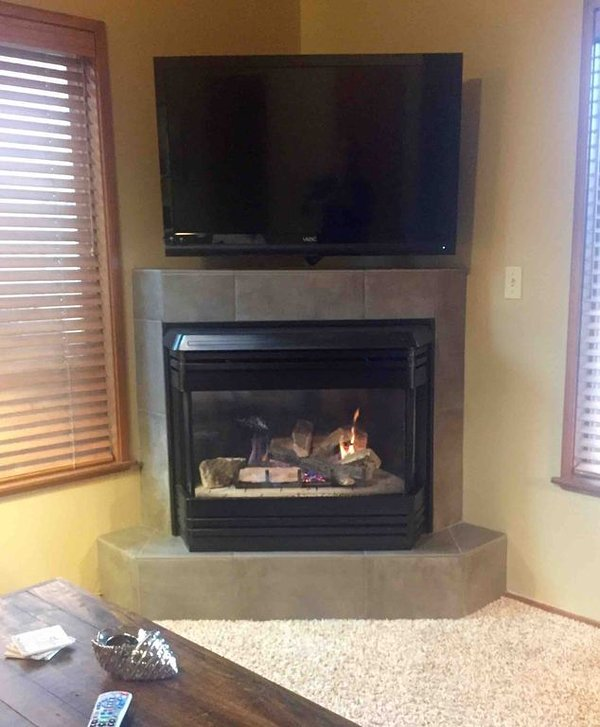 Gas fireplace and mounted flat screen television in the great room.