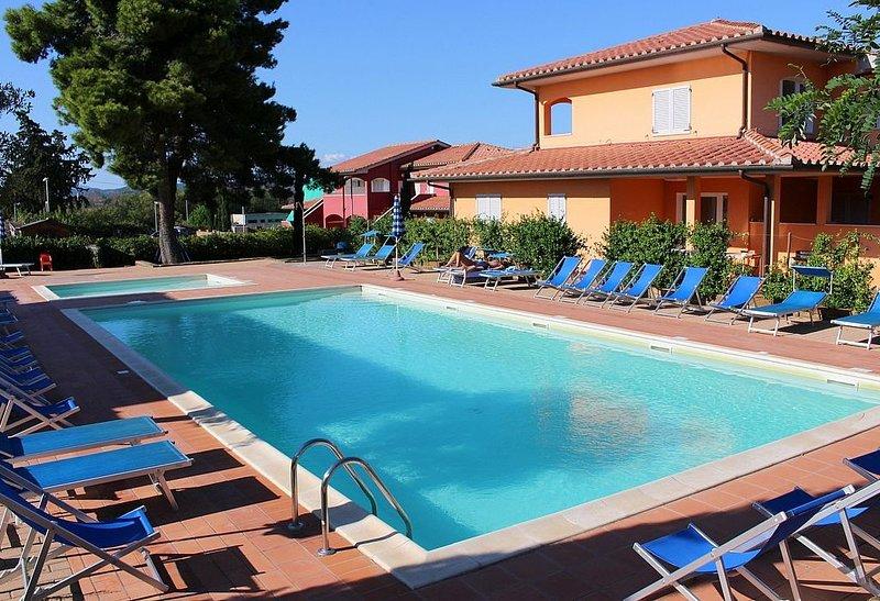 Casa Aliade E, rimborso completo con voucher*: Un accogliente appartamento che è, vacation rental in Pian D'Alma