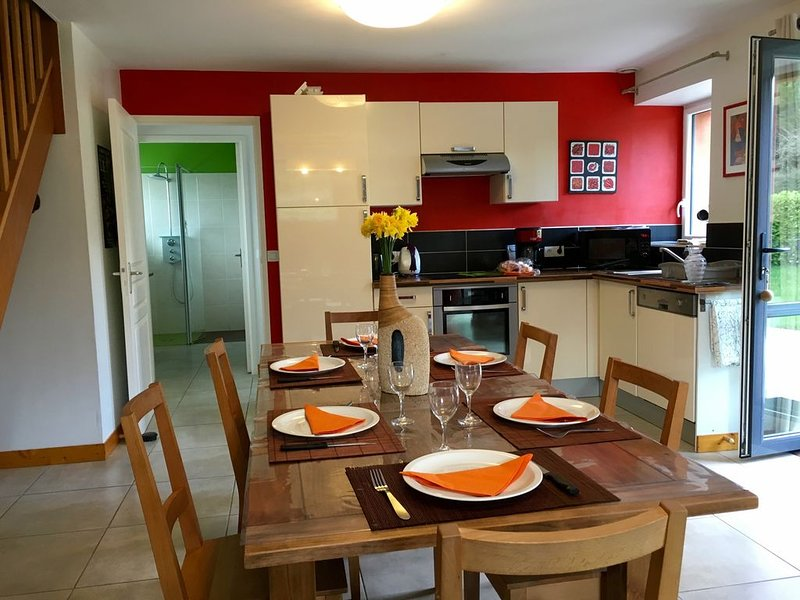 furnished and equipped kitchen open to a spacious and bright living room