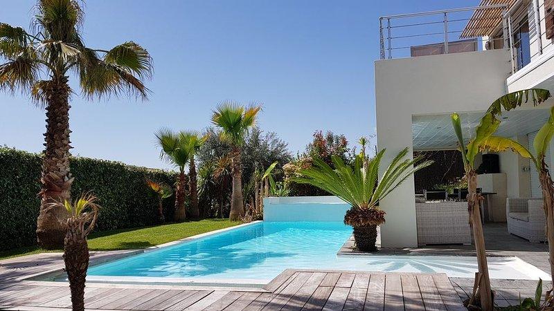 Villa 190m²  8 pers, piscine chauffée, vue exceptionnelle, jardin exotique, alquiler vacacional en Cournonterral