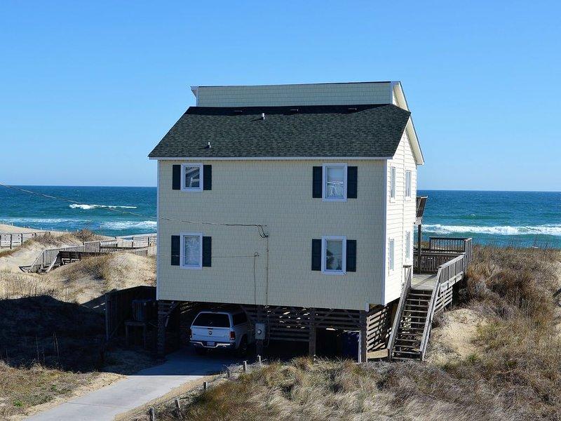 Parte trasera de la casa mirando al mar y la playa