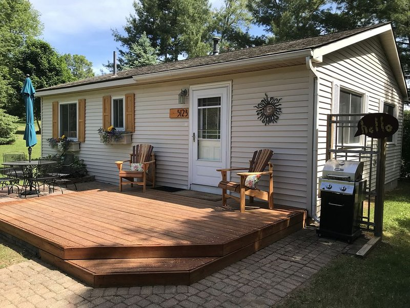 New cedar shutters, chairs, and address plate. Improvements every year!