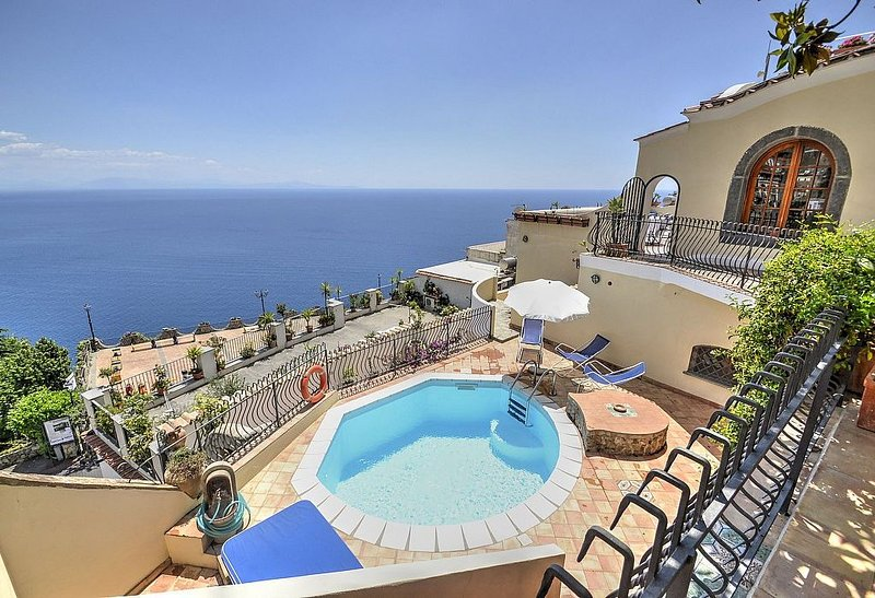 Villa Elvira is a splendid and luminous three-story villa built sheer above the, vacation rental in Praiano
