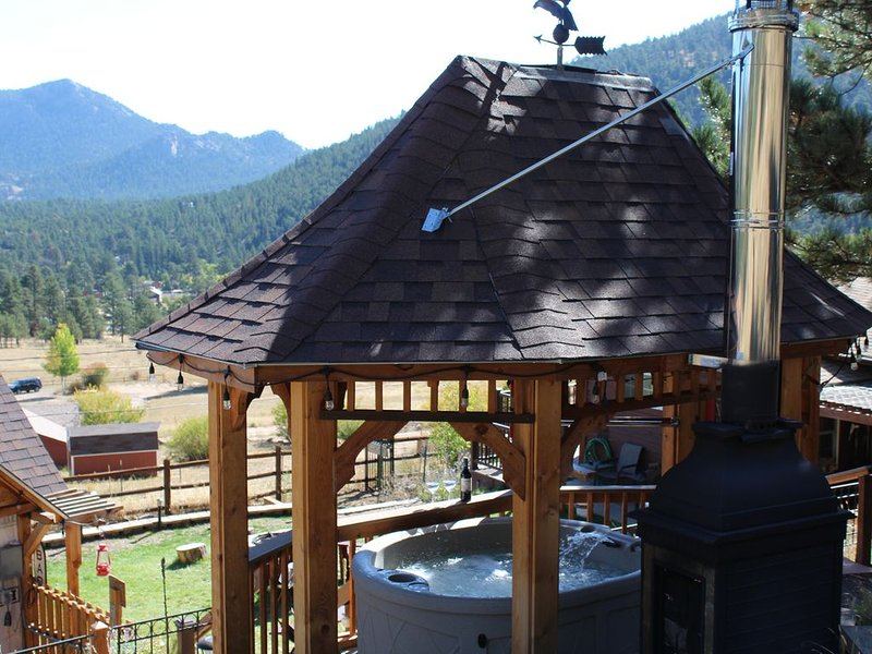 Romantic and private gazebo with hot tub and fireplace overlooking Estes Valley.
