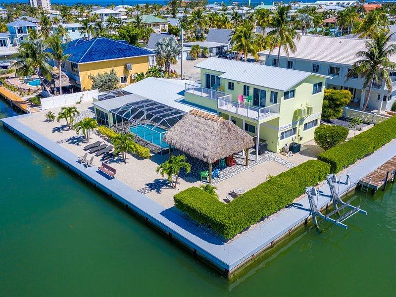 Call for Rates! Spring Special - $4,600 wk. Waterfront, pool & dock, aluguéis de temporada em Key Colony Beach