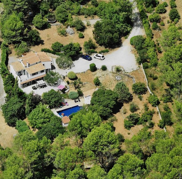 The cottage is on the right side of the pool, on the picture the trees hide it