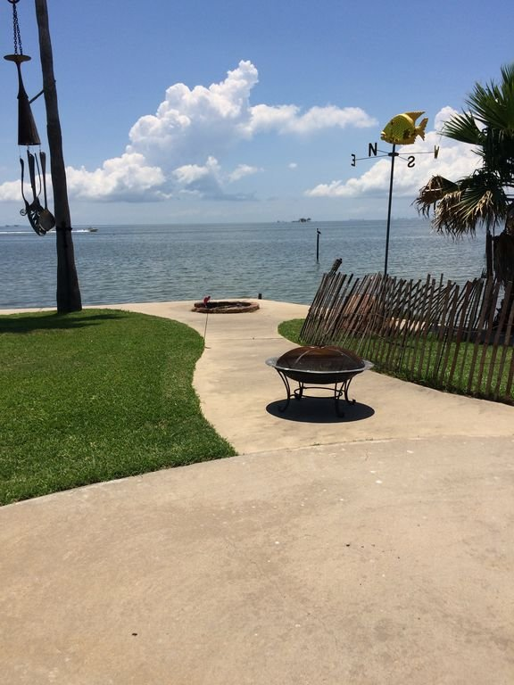Fire pit and view from studio on Galveston Bay
