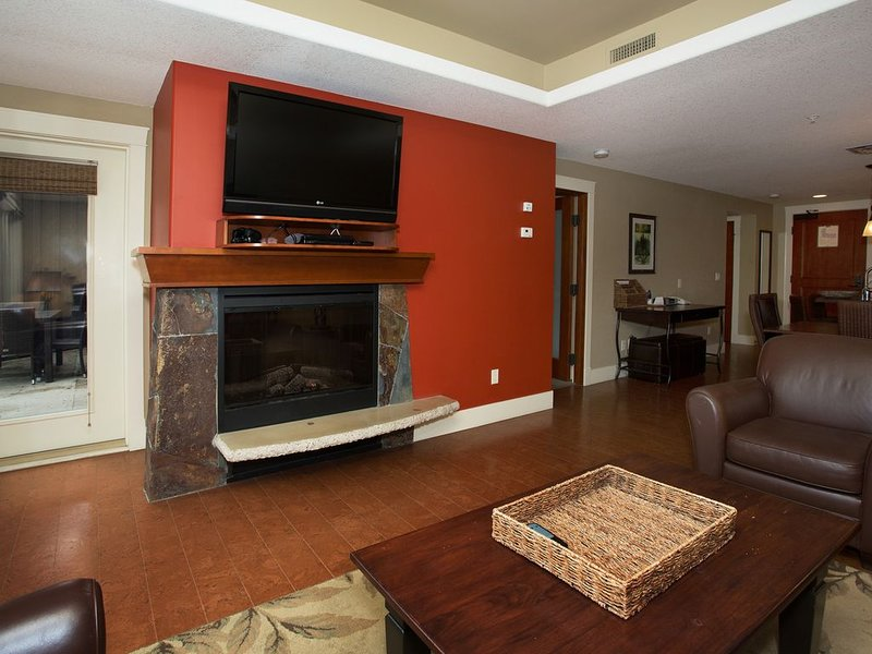 Cable TV and electric fireplace in the living room to keep you warm