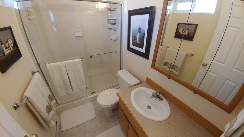 Bathroom with over size shower and extra thick towels. All the comforts of home!