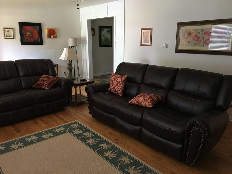 Spacious living room with reclining couches.
