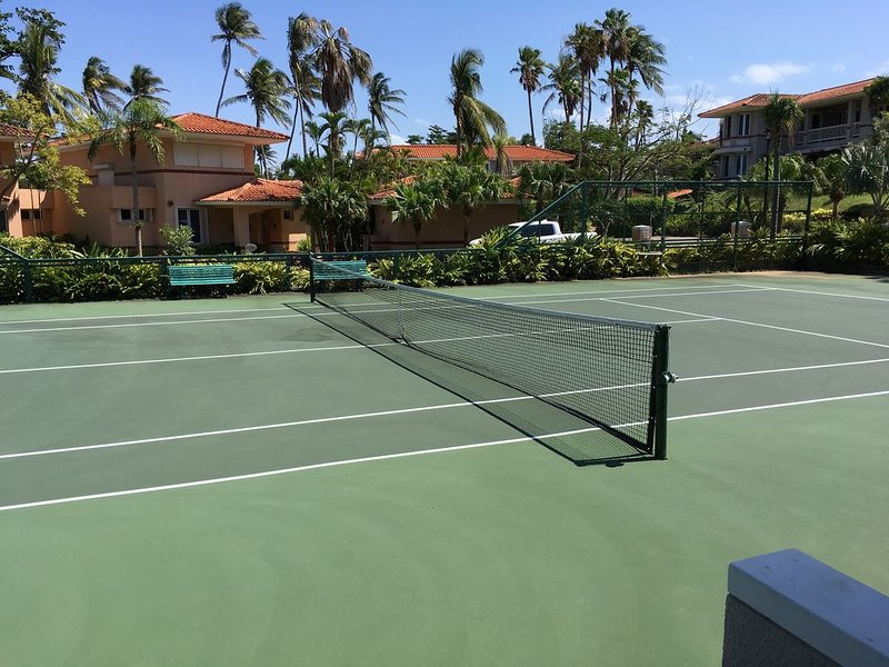 Tennis courts and pool area directly across from the villa.