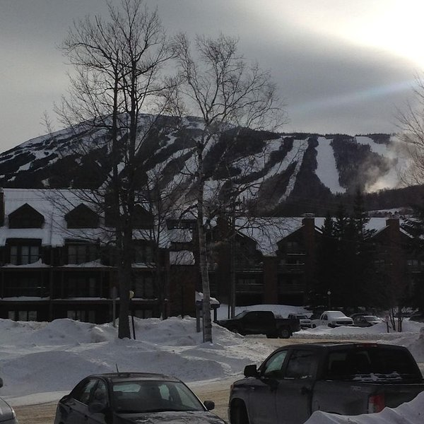 View of mountain and the Sports And Fitness Center from parking lot.