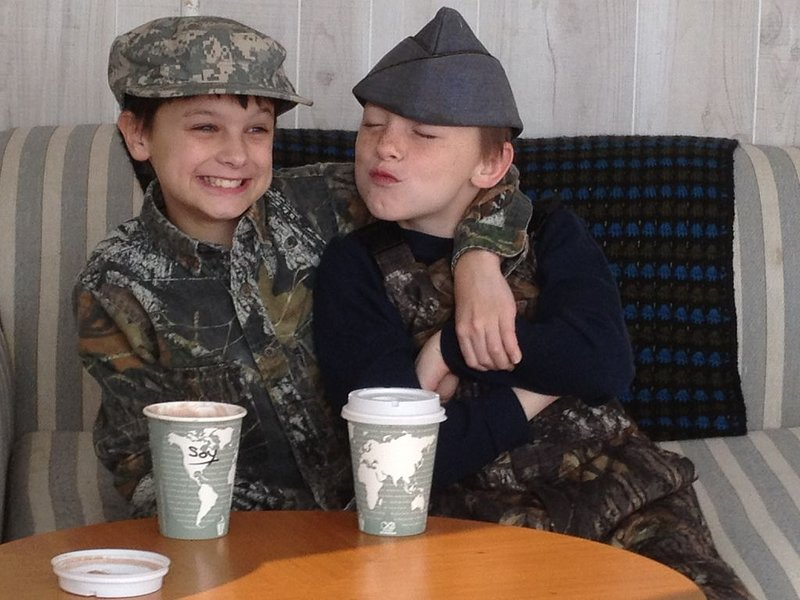 Our Precious with kissing army buddy...