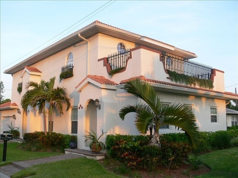 Custom built Spanish style home just steps to the white sandy beach.