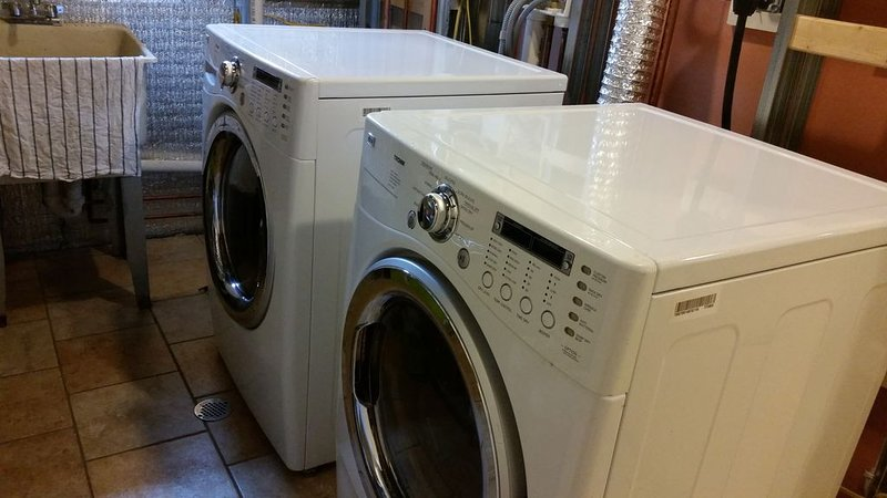 front loading washer & dryer in laundry room