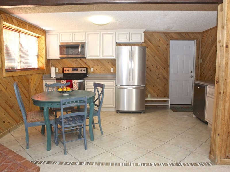 Brand new kitchen with stainless steel appliances.