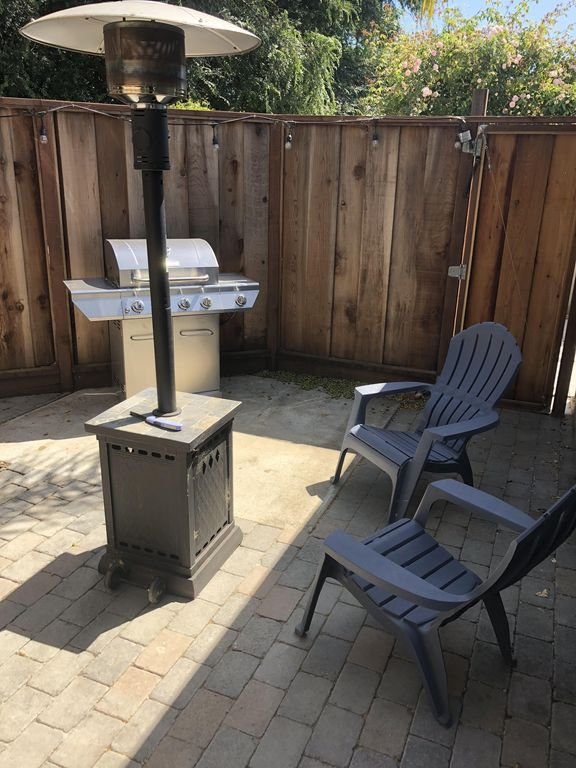 Back patio with BBQ, heat lamp, picnic bench and seating