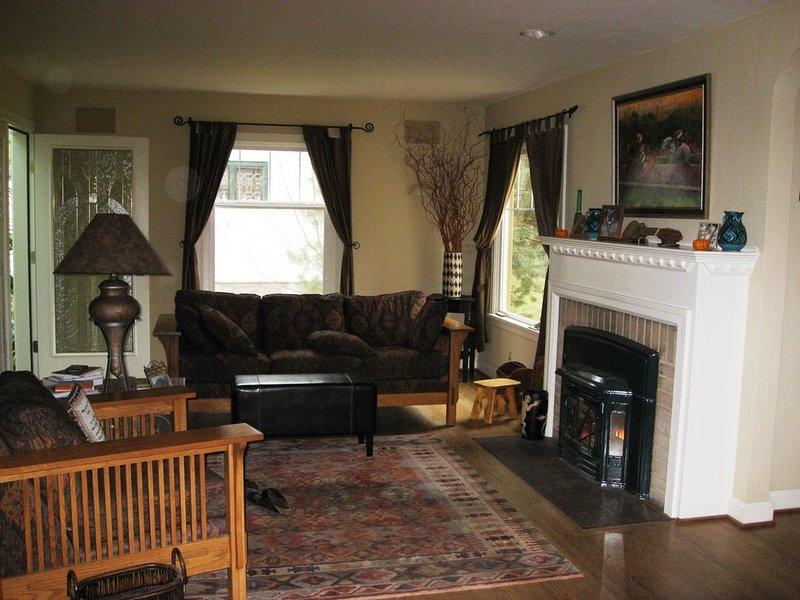Living room.  Door to sunroom in back left.