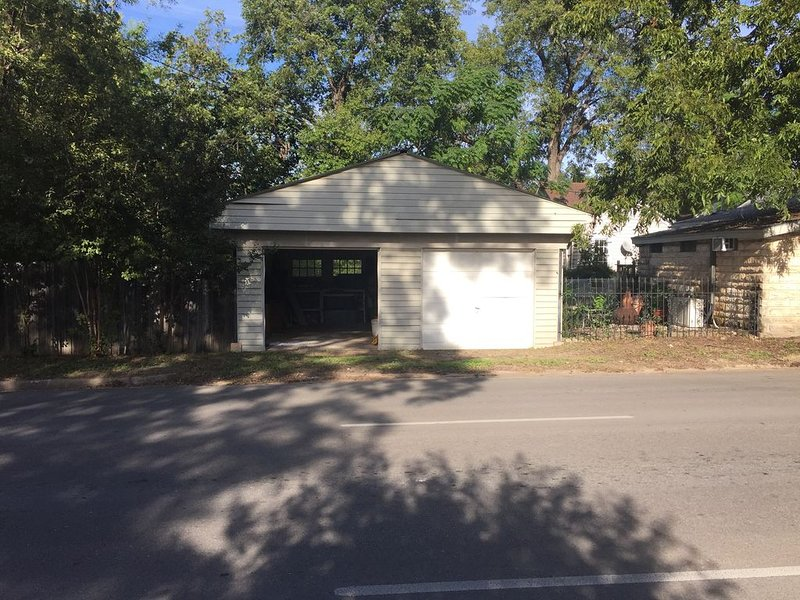 Our garage, located behind the house on a one way street, parks two vehicles
