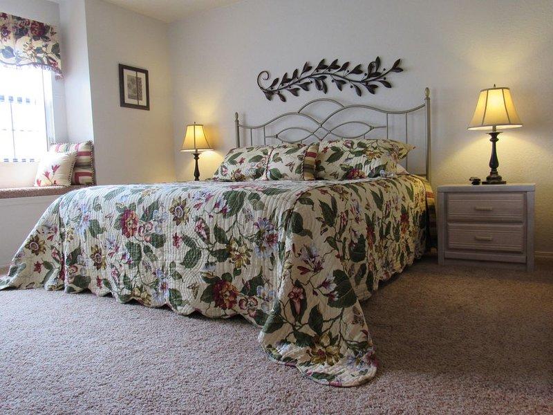 Chambre à coucher principale avec lit King